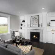 Fireplace With Built-in White Cabinets