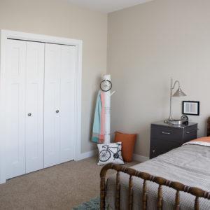 White Interior Bi-Fold Bedroom Closet Doors