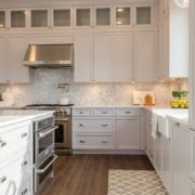Stainless Steel Stove Hood with White Cabinets